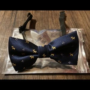 Carahere child's handmade bowtie with dog pattern